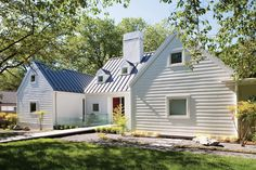 modern exterior elevation | simple set of 3 modern dormers | farmhouse metal roof | white clapboard exterior | Hugh Newell Jacobsen