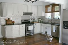 Great Kitchen remodel with links to detailed tutorials and sources. - She has my ugly cabinets and repainted them.