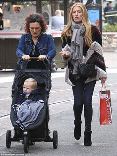 Staying cozy for Christmas! Cat Deeley let her friend push son Milo at The Grove mall in LA on Tuesday