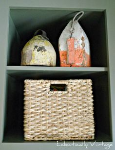 A bit of open shelving helps break up the expanse of dark cabinetry and is a place to show off old wooden buoys and a basket which holds Vintage Beach Decor, Wooden Barn Doors, Limestone Flooring, Artistic Tile, Built In Bench, Rustic Feel, Dressing Room, Mudroom, Wicker