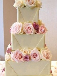white chocolate wedding cake envelope style with pink roses by Nicky Grant UK