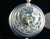 paua shell and silver round music box pendant