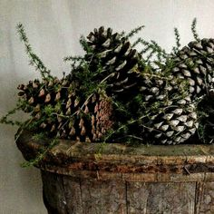 Yule style!! Pinecones in a wood tub or bowl!! Just right for decoration all Winter long!