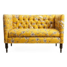 Classic in shape and perfectly tailored, this settee is upholstered in cotton fabric with an Asian branch motif. Handcrafted tufting and turned wooden legs add…