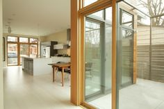 Indoor/Outdoor - open floor plan looking at dining and kitchen - by Architect Angelo Marasco