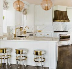 La Dolce Vita: A Bold and Glamorous Manhattan Apartment- Gold bar stools and hardware, love