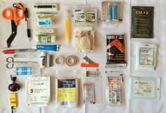 FR-1 Pouch.  Medical Shears / Pen / Thermometer / Tweezers / Tick Remover / Compression Bandage / Finger Bandage / Bandage / Savlon Cream / Glow Stick / Alcohol Wipes / Plasters / Medication / Celox Granules / Red Sharpie Pen / Syringe / Sterile Water / Lip Balm / Gaffa Tape /  Surgical Tape / Zinc Oxide Tape / Razor Blade / SWAT Tourniquet / Non-Adherent Dressings / Head Torch / Whistle / Non-Woven Swab / Triangular Bandage / Safety Pins / Burnshield / Steri-Strips / Mepore Dressing.
