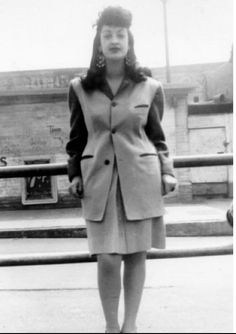 """1940s Fashion HistoryAlthough the man's suit is more well known, young women also participated in the rebellious 1940s Zoot and Zazou style. Some called their clothing """"defense"""