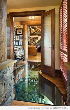 River under a house - Amazing house with glass floor and a river running under it.
