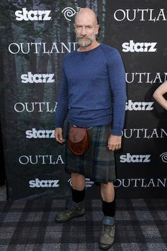 "July 25, 2014 - ""Outlander"" star and native Scot Graham McTavish, who plays war chieftain Dougal MacKenzie on the hit Starz show, arrived clad in a kilt for the the Comic-Con ""Outlander"" premiere in San Diego."