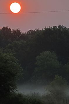 A early morning sun rises in Hinds County, Miss., near Jackson, Miss., Sunday, June 23, 2013. However, most public interest is still about the moon, which will reach its full stage Sunday, and is expected to be significantly closer to earth during a phenomenon known as supermoon. (AP Photo/Rogelio V. Solis)