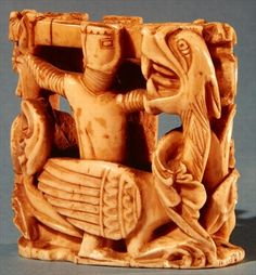 Chess piece in the form of a knight fighting a dragon (ivory) 13th century  France