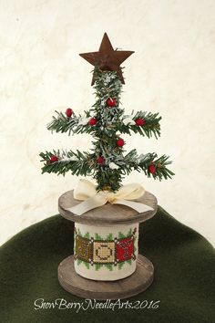 Repurposing a wooden spool for Christmas!                                                                                                                                                                                 More