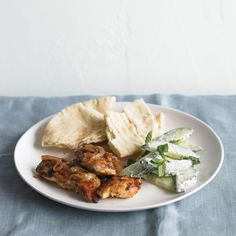 Marinate the chicken the day before and serve it with the pita bread and salad that only takes a few minutes to put together.