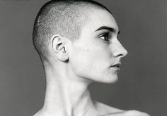 I really love it when women have shaved heads. It makes them so edgy, and high-fashion. On this woman in particular, it adds to her beautifully pronounced nose. I love it.