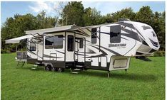 2015 Used Grand Design Momentum Toy Hauler in Tennessee TN.Recreational Vehicle, rv, 2015 Grand Design Momementum 388M, Dual Entry Doors with security sensors, Trailair Equal- Flex Suspension, Interior & Exterior Blue Led Light Accent Kits, Happi-Jac Electric Bunk Bed system w/ folding & removable sofas, 18 cubic foot SS refrigerator, New EdgeStar 2.0 cu.ft. Fastdry Ventless washer dryer combo, 5.5KW Onan Generator, 15k BTU A/C Living Room, 13.5K BTU Bedroom & Garage, 5K BTU Electric…