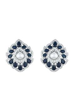 Featuring a pair of white rhodium plated stud earrings studded with faux polki and sapphire, set in mixed metal. CARE: Store them in moisture free areas and keep them away from water and liquid fragrances. Diamond Earrings, Stud Earrings, Pernia Pop Up Shop, Designer Earrings, Designer Wear, Rose Gold Plates, Gold Jewelry, Sapphire, Plating