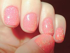 Coral with gold glitter nails