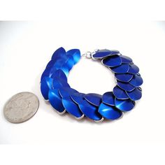Blue Dragon Scale Chainmail Bracelet ($25) ❤ liked on Polyvore featuring jewelry, bracelets, blue jewelry, blue bangles, polish jewelry, chain mail jewelry and special occasion jewelry