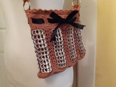 Dimensions: 9 L x 8.5 W inches Strap: 12 inches long (from shoulder) Tabs are INDIVIDUALLY crocheted by hand. Unlike other purses which have simple threads holding the tabs loosely together, this purse is designed to be durable and lasting. The quality of the work speaks for itself.