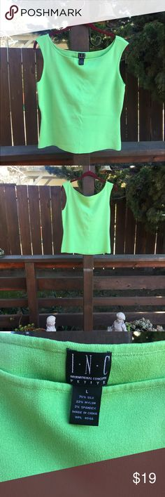 Bright green knit tank (new) This is a pretty bright green INC knit tank, new without tags. Wear it by itself or as a camisole with your spring outfits. Great quality INC International Concepts Tops Tank Tops