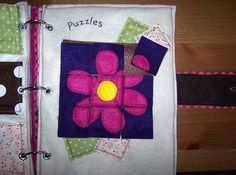 Make a puzzle. Other page has a pocket for the pieces. There are 3 pockets with 3 different puzzles.