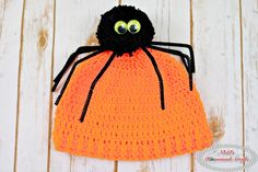 This Spider Pom-Pom Hat is a free crochet pattern that comes with many photos and a video and can be adjusted to make it for any size head!