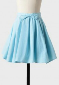 Blue skirt with a cute bow detail on the waist.