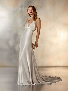 Sensuous dress in soft, silver satin with delicate, mini-meteor beaded details in cross-over straps