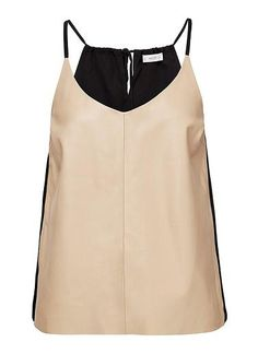 100 % Leather/Polyester cami. Neat fitting silhouette features a leather front panel. Available in Multi as seen below.