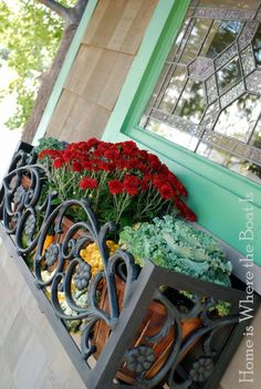 Fall window box:  love the wrought-iron look!  Wonder if you could get this effect using plastic scrolled iron-looking short fences but painted black?  Worth a try!