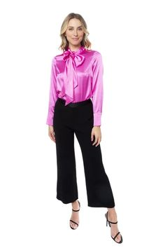 This bright blouse in Jasmine has a high neckline with self-tie straps, and long sleeves with button cuffs. Model wears: US Model's height SILK SPANDEX. The Selection, Neckline, Spandex, Silk, Long Sleeve, Blouses, Sleeves, Model, Pants