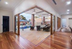 Timber stacker doors create an open corner to outside #stacker #doors #sliding #timber #corner #window #sketchbuildingdesign