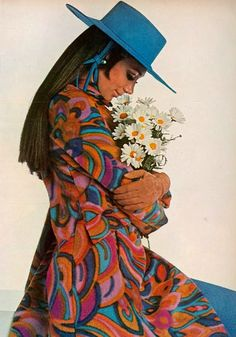 Model Marisa Berenson photographed by Penati wearing a coat by Bill Blass for Maurice Rentner and hat by Halston.Vogue,August 1967.