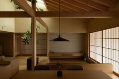 hearth architects has topped this family house in hikone, japan, with a gabled roof whose extended eaves create a sheltered veranda. Interior Exterior, Interior Architecture, Japan Interior, Asian Home Decor, Architect House, Japanese House, Hearth, Decoration, Living Spaces