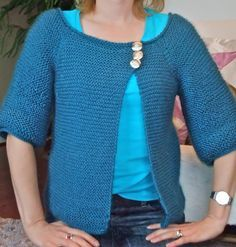 Free Knitting Pattern for Garter Stitch Swingy Cardigan - Jenn Pellerin's simple asymmetrical top-down raglan cardigan is worked in all knit stitches. Rated as easy by more than 100 Raverlrers. Pictured project by lbeckste