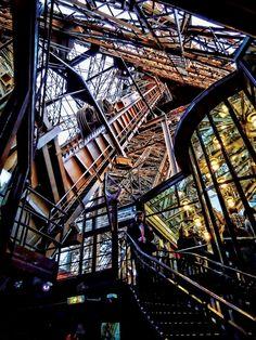 https://flic.kr/p/9RBYDm   The Eiffel Tower. A look at the inside...   The Eiffel Tower (French: La Tour Eiffel, [tuʁ ɛfɛl], nickname La dame de fer, the iron lady)