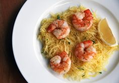 """roasted shrimp over spaghetti squash """"noodles"""" is a healthful option for those craving the comforting flavors of traditional scampi. You'll love the crunchiness of the bed of squash against the texture of the simple roasted shrimp. Seafood Recipes, Paleo Recipes, Low Carb Recipes, Cooking Recipes, Dinner Recipes, Noodle Recipes, Delicious Recipes, Dinner Ideas, Protein Recipes"""