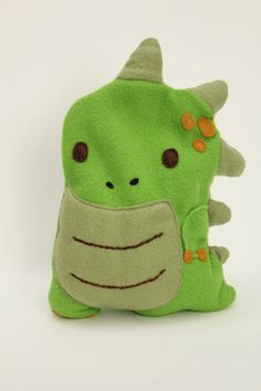 Would be awesome in felt - Dinosaur Heating Pad Corn Bags, Rice Bags, Sewing Crafts, Sewing Projects, Heat Bag, Hot Cold Packs, Crafty Craft, Crafting, Sewing For Kids