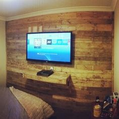 Diy pallet wall with floating shelf