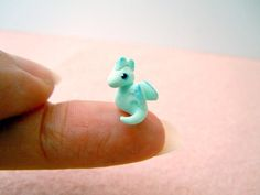 Tiny dragon in light mint green - micro pocket dragon.