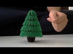 ▶ How to make 3d origami Christmas tree - YouTube....I wish I had origami skill.