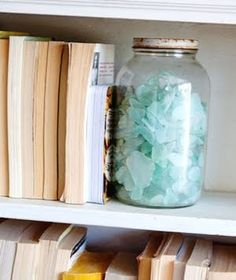jar with seaglass..... hate the seaglass but i like the idea of this being a bookend...maybe with something else in it...