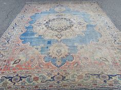 Faded persian rug could add color to a neutral room.