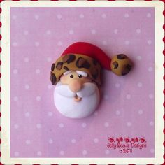 leopard santa $3.75. So cute! Pinned to remind me we can make pins with the scouts.