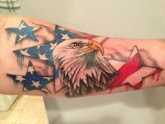 This incredibly realistic 3D eagle pops right off the skin. #InkedMagazine #eagle #patriotic #tattoo #america #flag #Inked #ink #art #stars