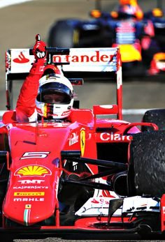Sebastian Vettel (Scuderia Ferrari) crosses the line to win at the Hungagoring in Hungary
