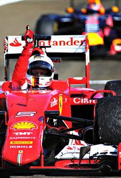 Sebastian Vettel (Scuderia Ferrari) crosses the line to win at the Hungagoring in Hungary