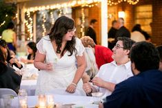 """9 Tips for Being Married to a Teacher  # 2. Yes, we're bossy.  The picture above was taken at my wedding. I was telling my brother, """"Go get your own salsa!"""" (Seriously, I remember the conversation.) That is my """"you better do it"""" face, and I couldn't even turn it off at my wedding. Do you see his face? It cracks me up every time I see it."""