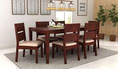 The finely crafted dining table set will certainly glorify the #decor of your dining room. The mahogany finish over Sheesham wood makes this #dining #table #set very appealing. View more on: https://www.woodenstreet.com/6-seater-dining-table-sets